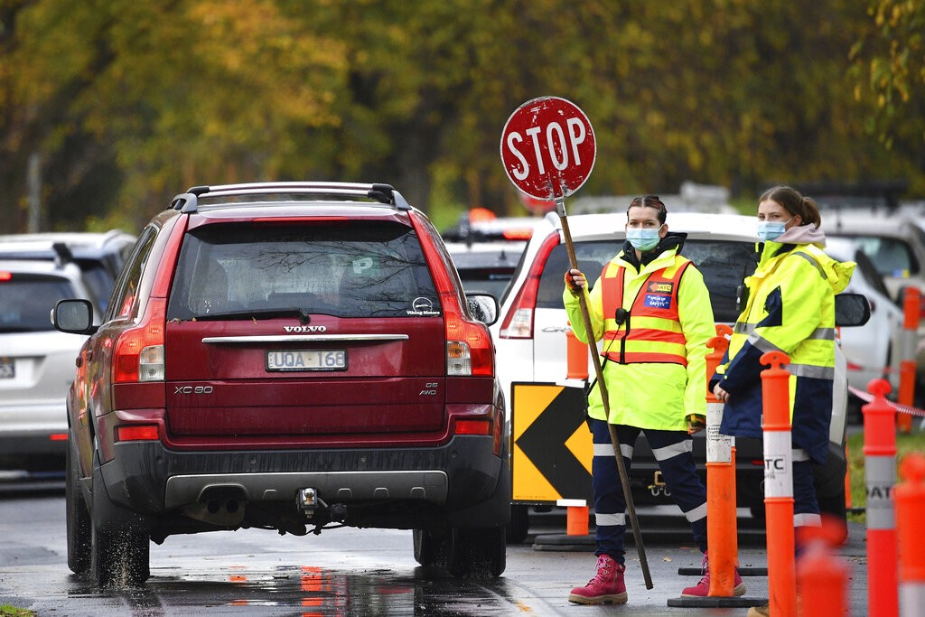 Traffic is controlled at a COVID-19 testing facility in Melbourne, Australia,May 27, 2021.