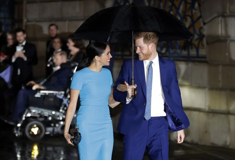 Britain's Prince Harry and Meghan, the Duke and Duchess of Sussex arrive at the annual Endeavour Fund Awards in London, March 5, 2020.