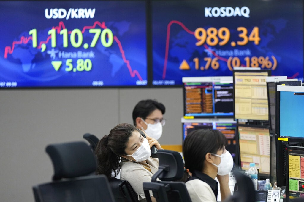 A currency trader talks on the phone at the foreign exchange dealing room of the KEB Hana Bank headquarters in Seoul, South Korea, Monday, June 7, 202...