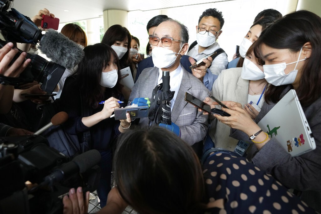 Lim Chul-ho, center, the son of a deceased forced laborer, speaks at the Seoul Central District Court in Seoul, South Korea, Monday, June 7, 2021.