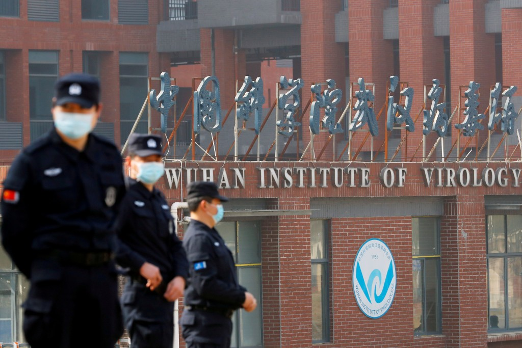 Security personnel keep watch outside WuhanInstitute of Virologyduring the visit by WHOteam. (Reuters photo)