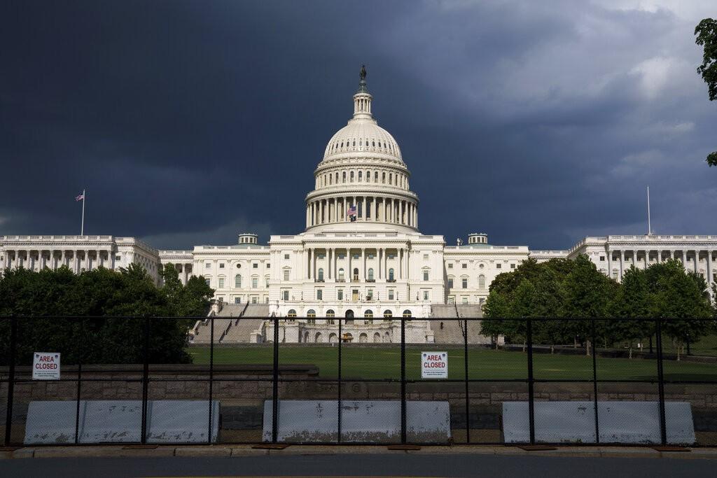 The U.S. Capitol is seen under dark skies in Washington, Tuesday, June 8, 2021.