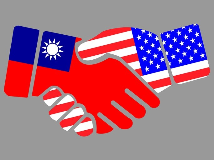 Taiwan and US flags handshake illustration. (gettyimages)