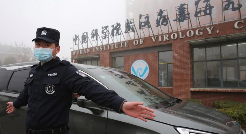 Security guard blocks media from Wuhan Institute of Virology.