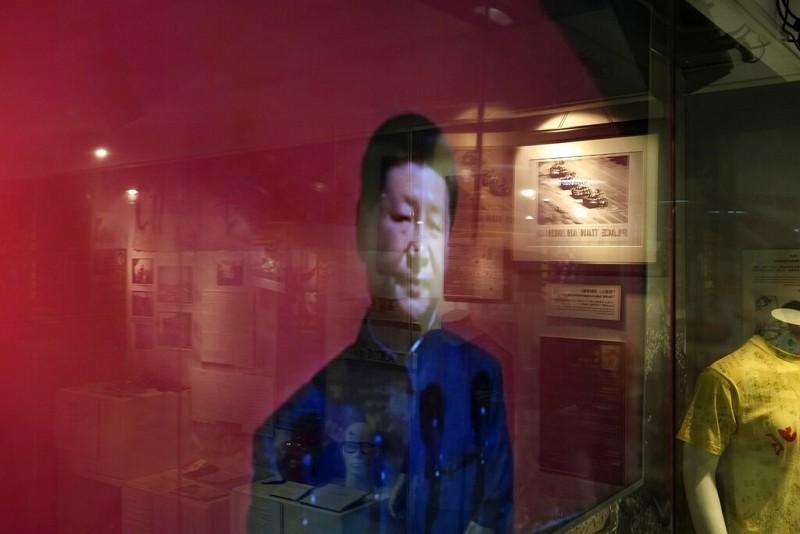 習近平出現在香港六四紀念館電視螢幕上(圖/美聯社)