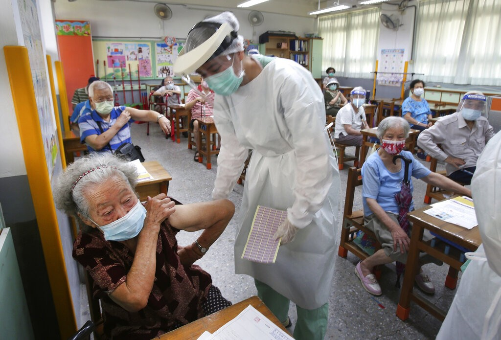 Elderly Taiwanese people prepare to receive the AstraZeneca COVID-19 vaccine at a primary school in Taipei, Taiwan, Tuesday, June 15, 2021.