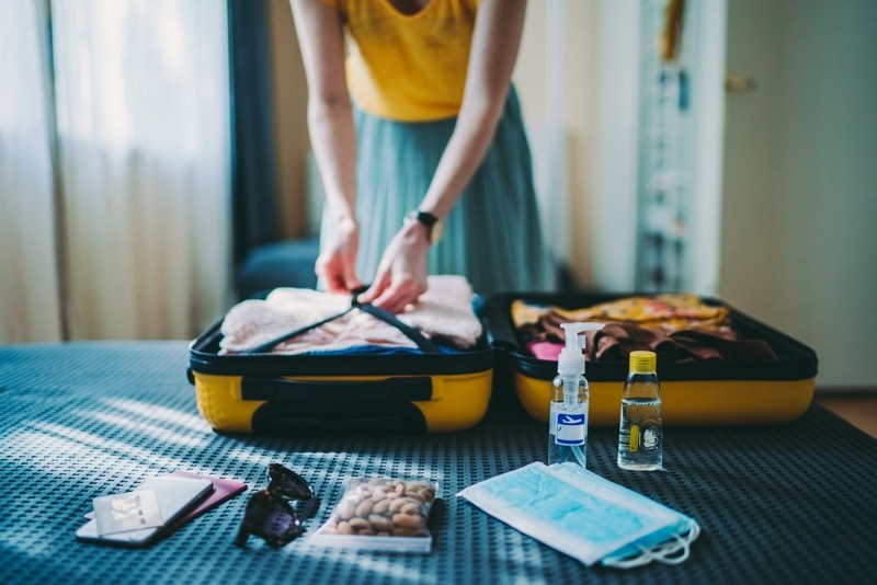 Woman packing suitcase (Getty Images)