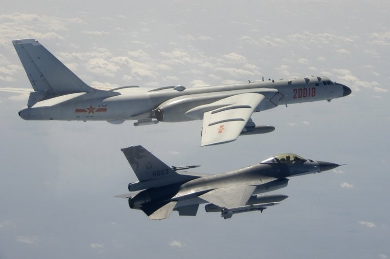 A Chinese H-6 bomber (top) and a Taiwanese F-16 in Feb. 2020 (AP, Ministry of National Defense photo)