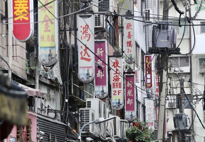 Signs for tea parlors seen in Taipei's Wanhua District.