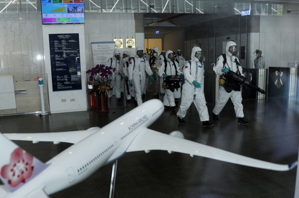 A disinfection crew working at a Taiwanese airport in May