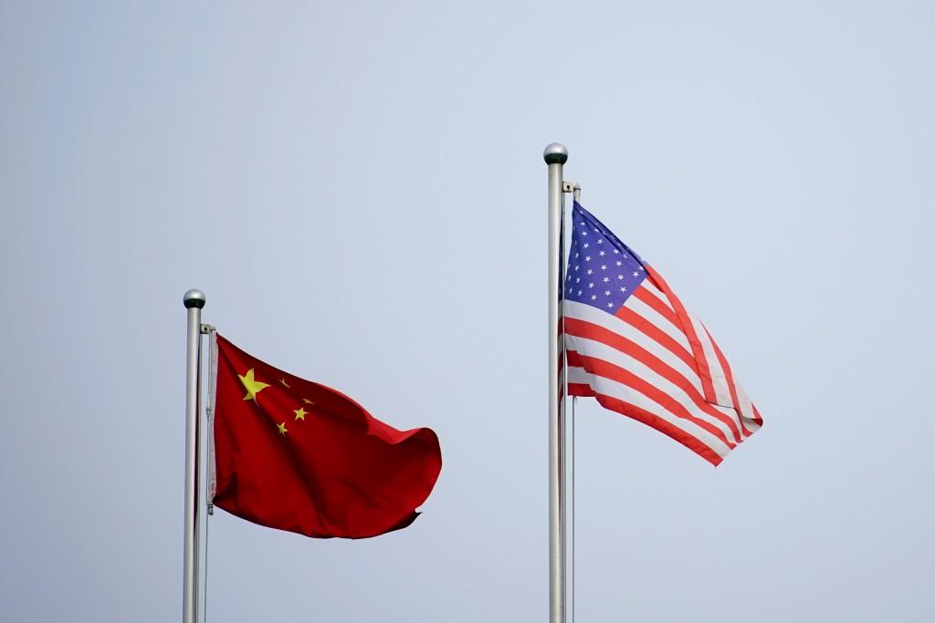 根據路透社,拜登政府最快於週五(9日)將14家中國公司及其他實體列入經濟黑名單。(圖/路透社)