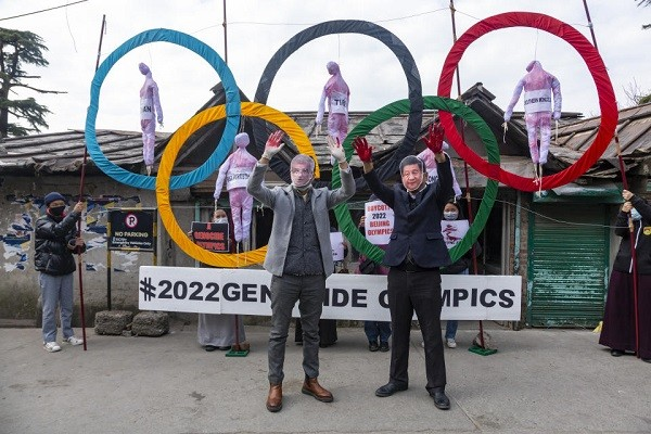 Activists wearing masks ofIOC President Thomas Bach and Chinese leader Xi Jinping in front of the Olympic rings during street protest in Dharmsa...