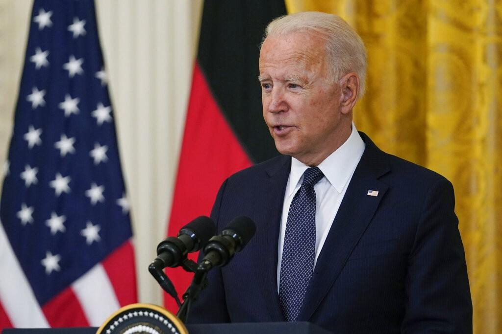 President Joe Biden speaks during. News conference with German Chancellor Angela Merkel in the East Room of the White House in Washington, Thursday, J...