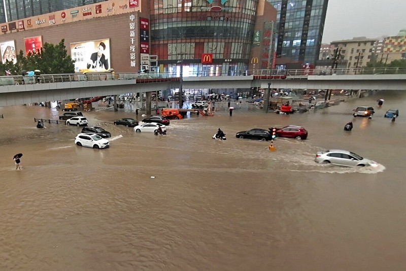 Vehicles are stranded after a heavy downpour in Zhengzhou city, central China's Henan province on Tuesday, July 20, 2021.