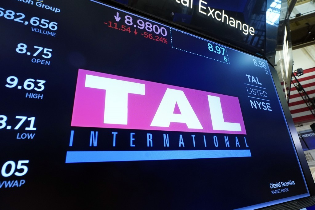 The logo for China's TAL Education Group appears above a trading post on the floor of the New York Stock Exchange, Friday, July 23, 2021.