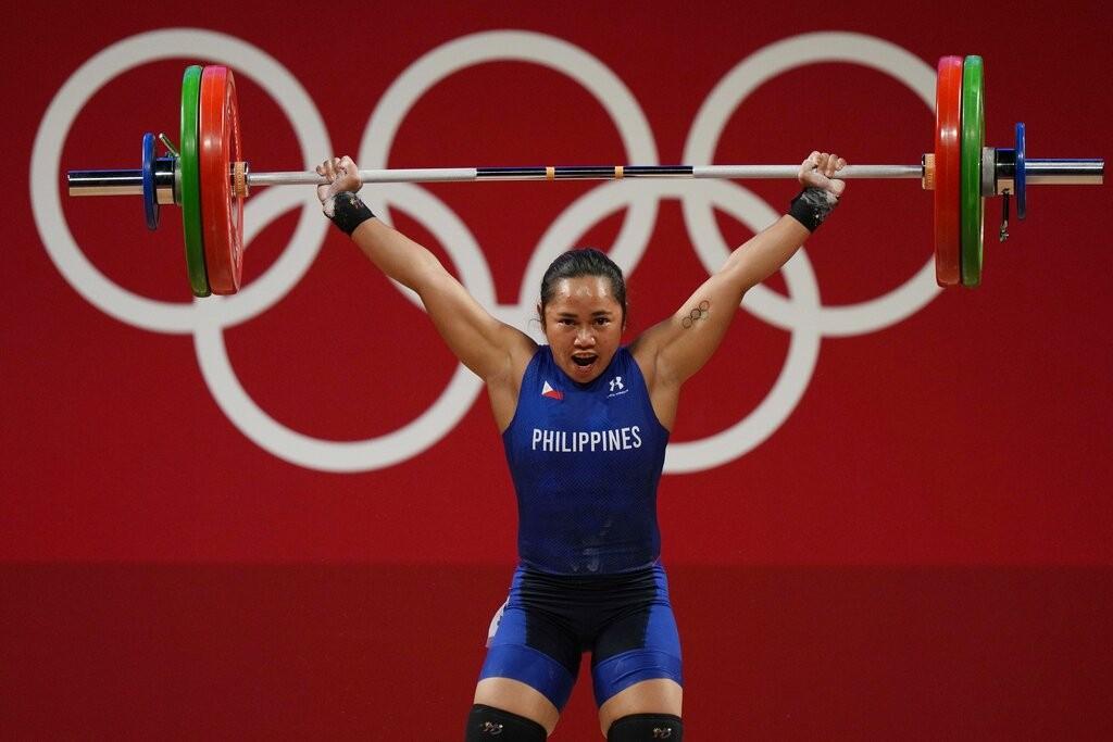 Hidilyn Diazcompetes in women's 55 kg weightlifting eventat 2020 Summer Olympics.