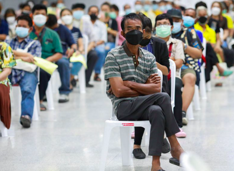 People queue at the Central Vaccination Center as Thailand begins offering first doses of the AstraZeneca vaccine to at-risk groups amid the coronavir...