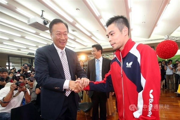 Foxconn founder Terry Gou (left) and table tennis player Chuang Chih-yuan