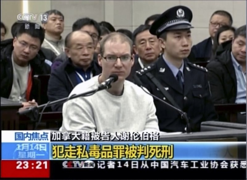 In this image taken from a video footage run by China's CCTV, Canadian Robert Lloyd Schellenberg attends his retrial at the Dalian Intermediate Pe...