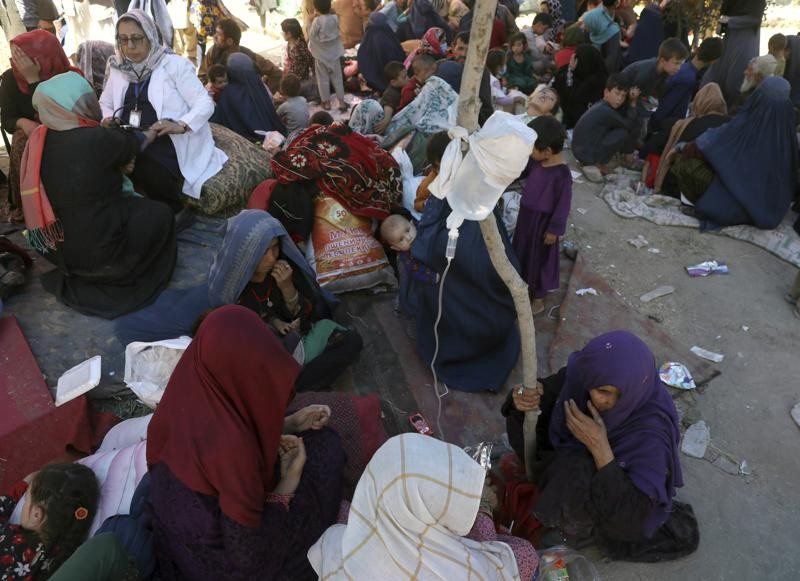 Internally displaced Afghan women from northern provinces, who fled their home due to fighting between the Taliban and Afghan security personnel, rece...