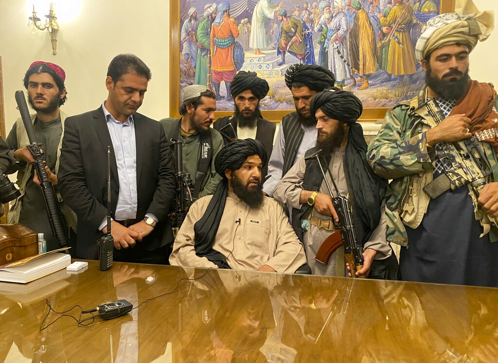 Taliban fighters take control of Afghan presidential palace on Aug. 15, 2021.