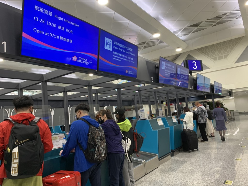 Travelers at Taiwan Taoyuan International Airport checking in for a flight to Palau on Aug. 14.