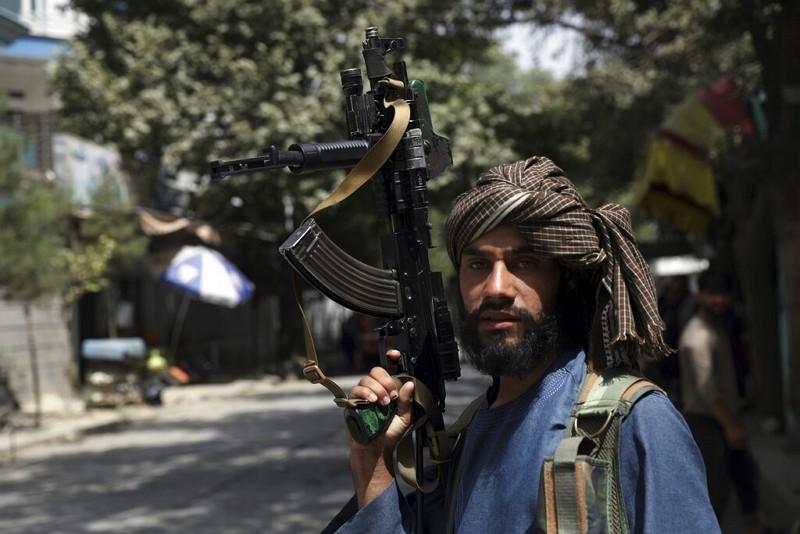 Taliban fighter stands guard atcheckpoint inWazir Akbar Khan neighborhood inKabul.