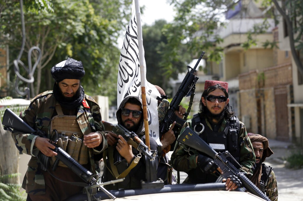Taliban fighters fly their flag while on patrol in Kabul, Afghanistan onThursday (Aug. 19.)