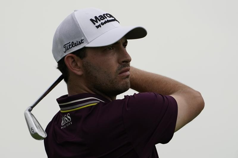 Patrick Cantlay watches his shot off the fourth tee in the third round at the Northern Trust golf tournament, Saturday, Aug. 21, 2021, at Liberty Nati...