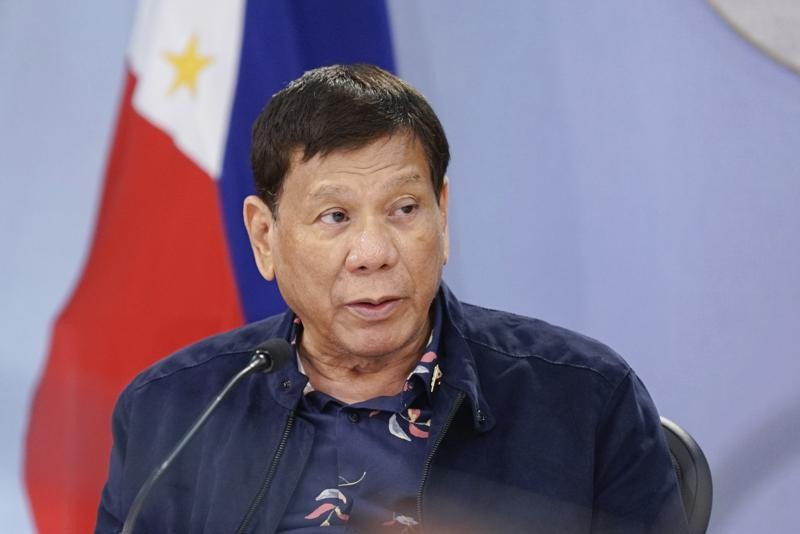 In this photo provided by the Malacanang Presidential Photographers Division, Philippine President Rodrigo Duterte talks during a meeting with the Int...