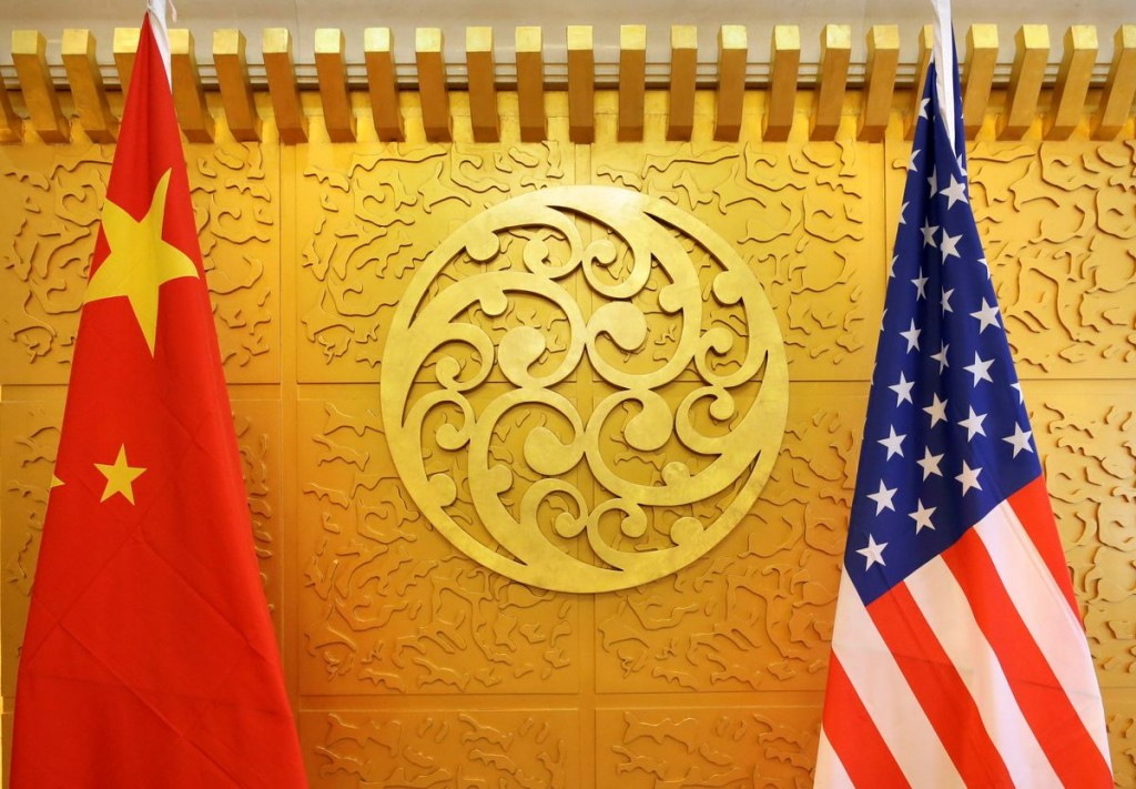 Chinese and U.S. flags are set up for a meeting at China's Ministry of Transport in Beijing, China April 27, 2018. REUTERS/Jason Lee