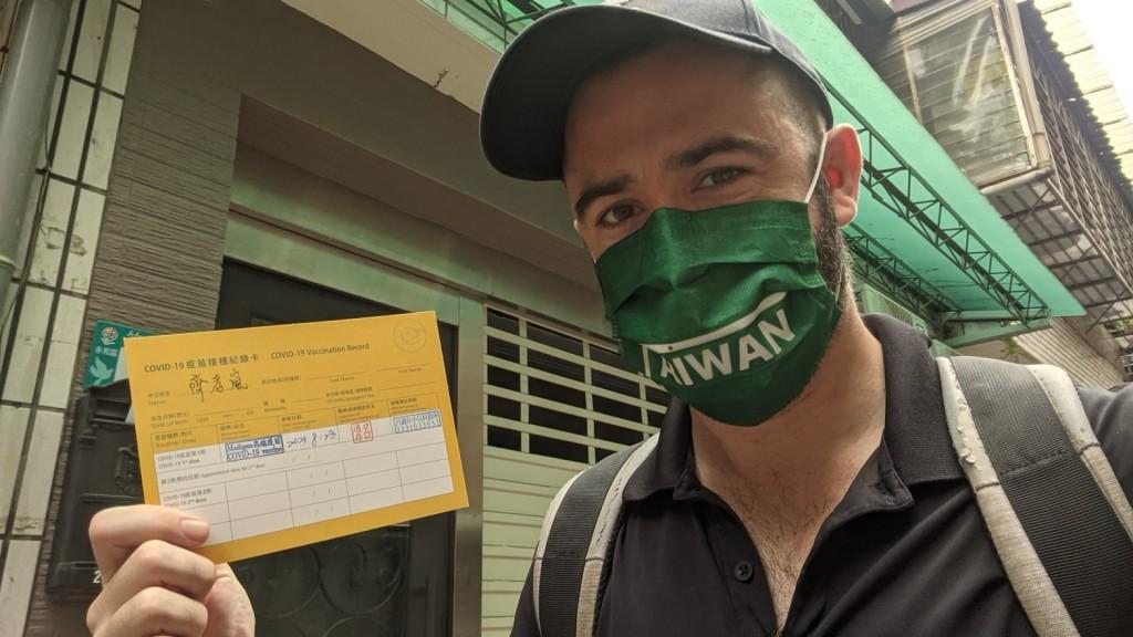 Teachey holding up his vaccination card. (Alex Teachey photo)