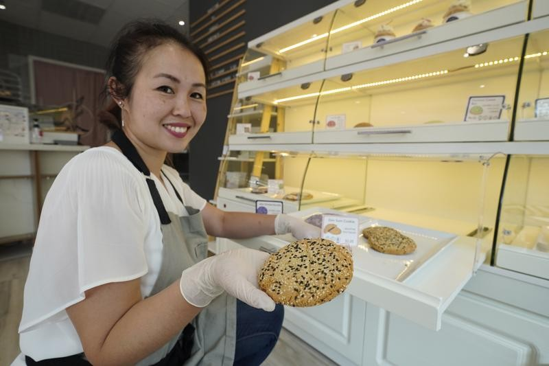 Pastry chef Elaine Lau holds a Dim Sum Cookie at the Sunday Bakeshop in Oakland, Calif., Thursday, Aug. 19, 2021. From ube cakes to mochi muffins, bak...