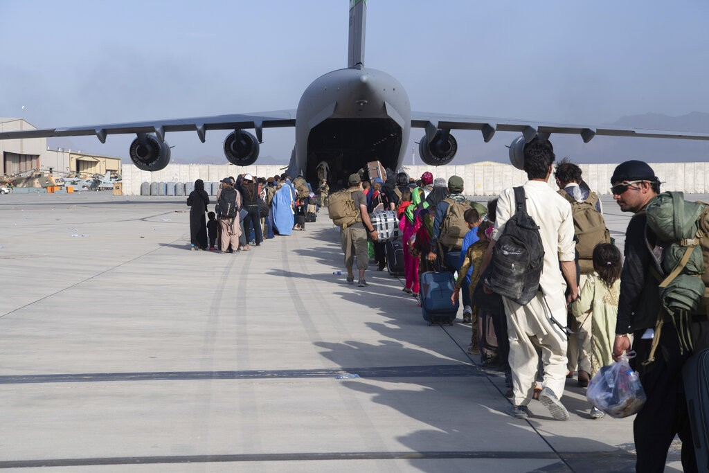 U.S. Air Force loadmasters and pilots load people being evacuated from Afghanistan onto a U.S. Air Force C-17, Aug. 24, 2021.
