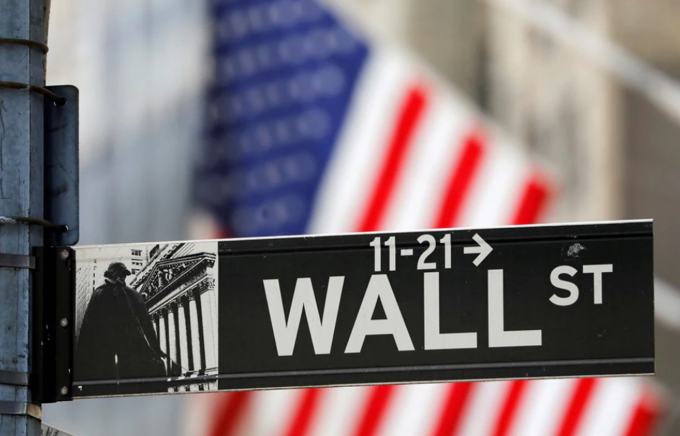 A street sign for Wall Street is seen outside the New York Stock Exchange (NYSE) in New York City, New York, U.S., July 19, 2021. REUTERS/Andrew Kelly...