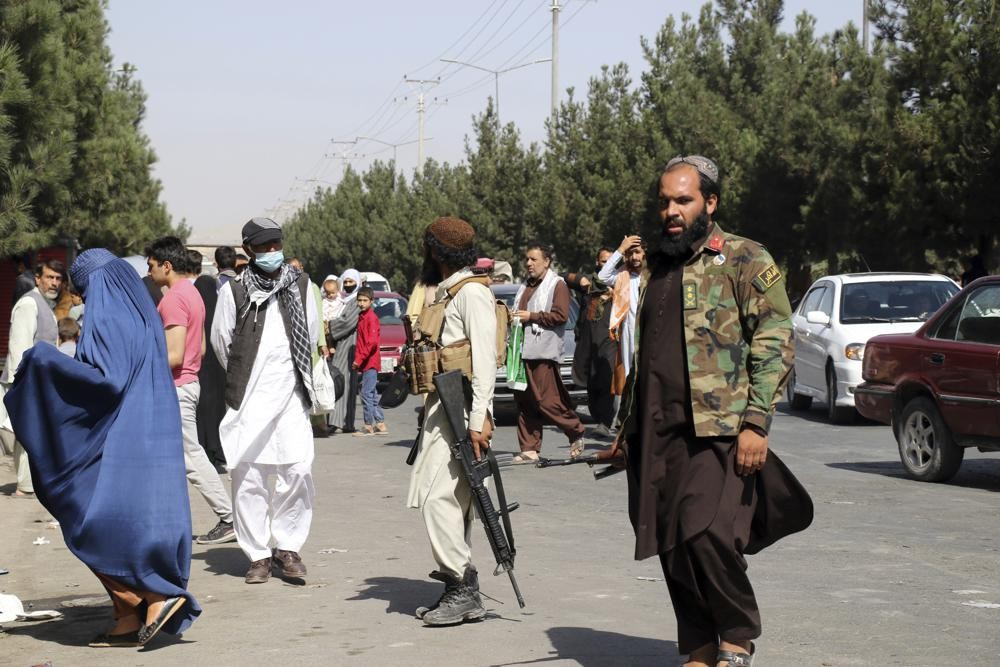 Taliban fighters outside Kabul airport after the attacks.