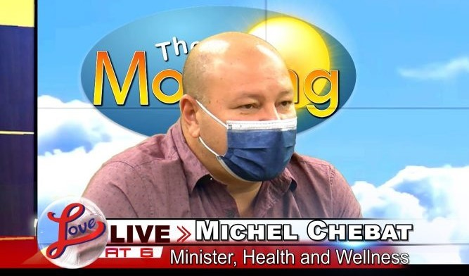 Belize Minister of Health and Wellness Michel Chebat giving radio interview onLove FM. (Love FM photo)