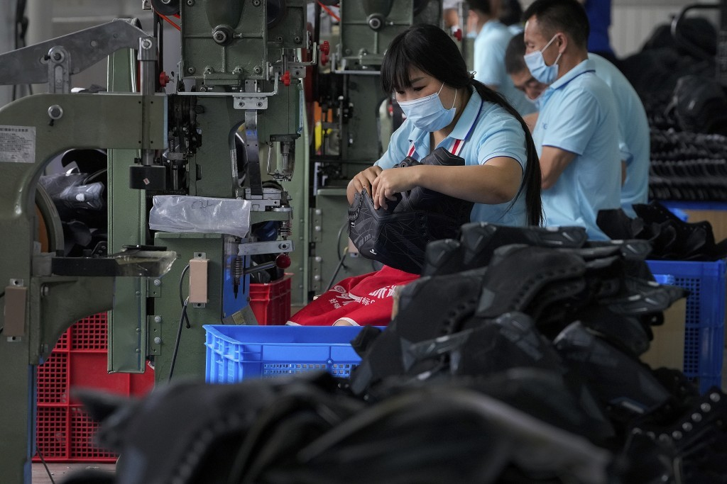 China August factory activity seen growing at slightly slower pace: Reuters poll