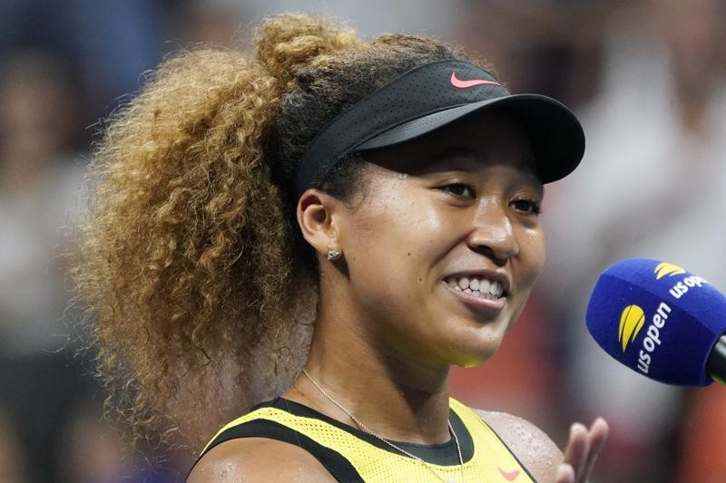 Naomi Osaka, of Japan, speaks to the crowd after beating Marie Bouzkova, of the Czech Republic, during the first round of the US Open tennis champions...