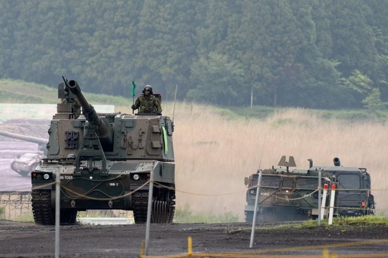 Japan's Ground Self-Defense Forces (JGSDF) soldiers take part in a live fire exercise at the JGSDF's training grounds in the East Fuji Manueve...