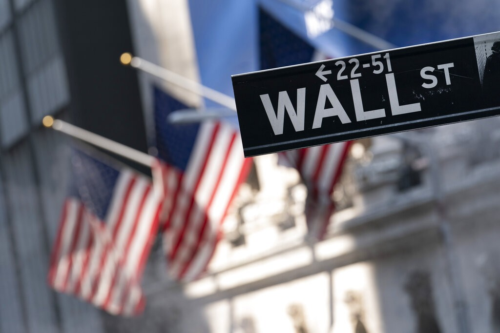 A sign for Wall Street hangs in front of the New York Stock Exchange, July 8, 2021.