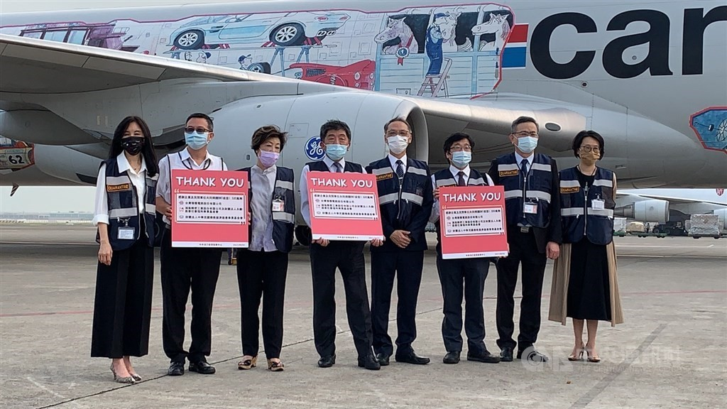 Taiwanese officials including Chen Shih-Chung (4th from left) greet Cargolux flight carrying BioNTech vaccines.