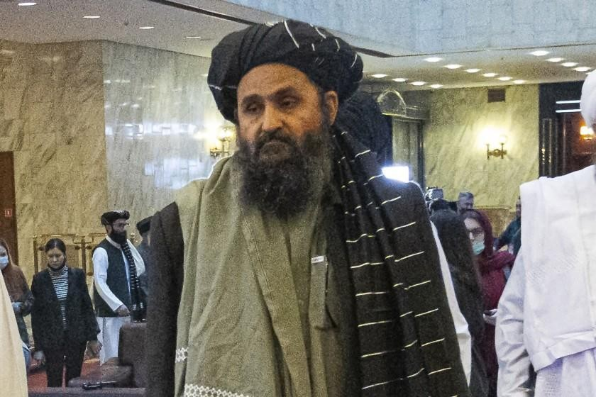 In this March 18, 2021, file photo, Taliban co-founder Mullah Abdul Ghani Baradar, arrives with other members of the Taliban delegation for an interna...