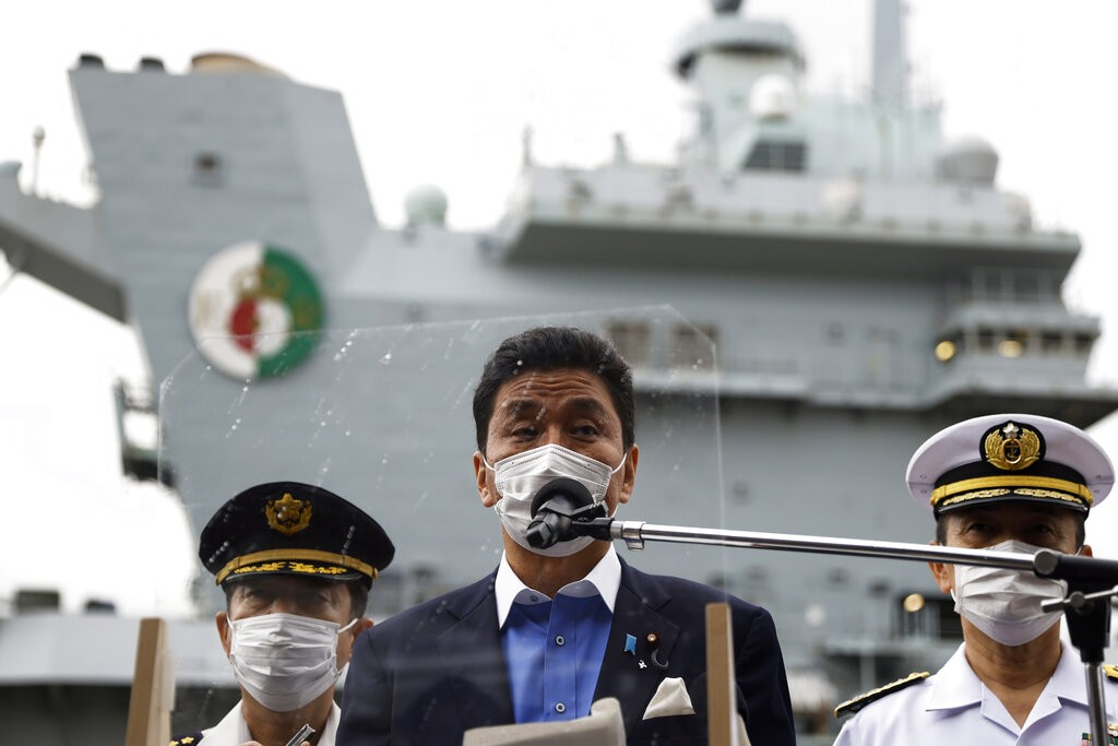 Japan's Defense Minister Nobuo Kishi, center, speaks to the members of the media after he inspected the British Royal Navy's HMS Queen Elizabe...