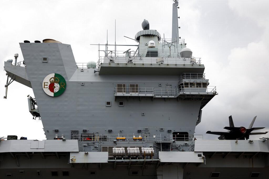The British Royal Navy's HMS Queen Elizabeth aircraft carrier sits anchored at the U.S. naval base in Yokosuka, Kanagawa Prefecture, Japan Monday,...