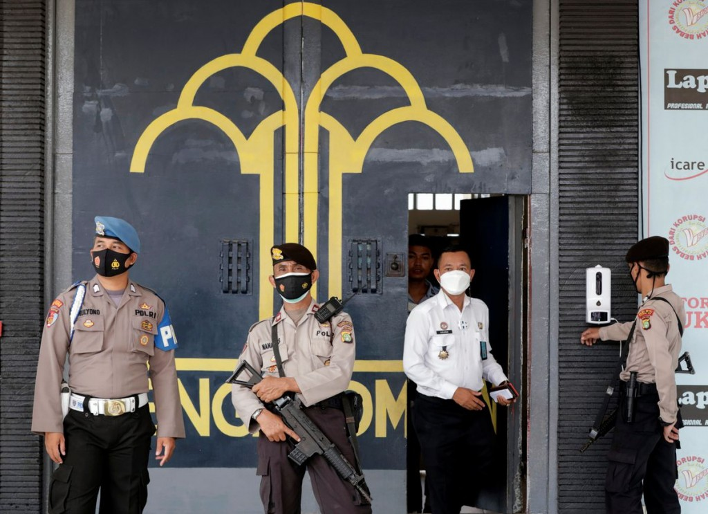 Police officer guards at the main entrance gate of Tangerang prison following a fire overnight at an overcrowded jail in Tangerang on the outskirts of...
