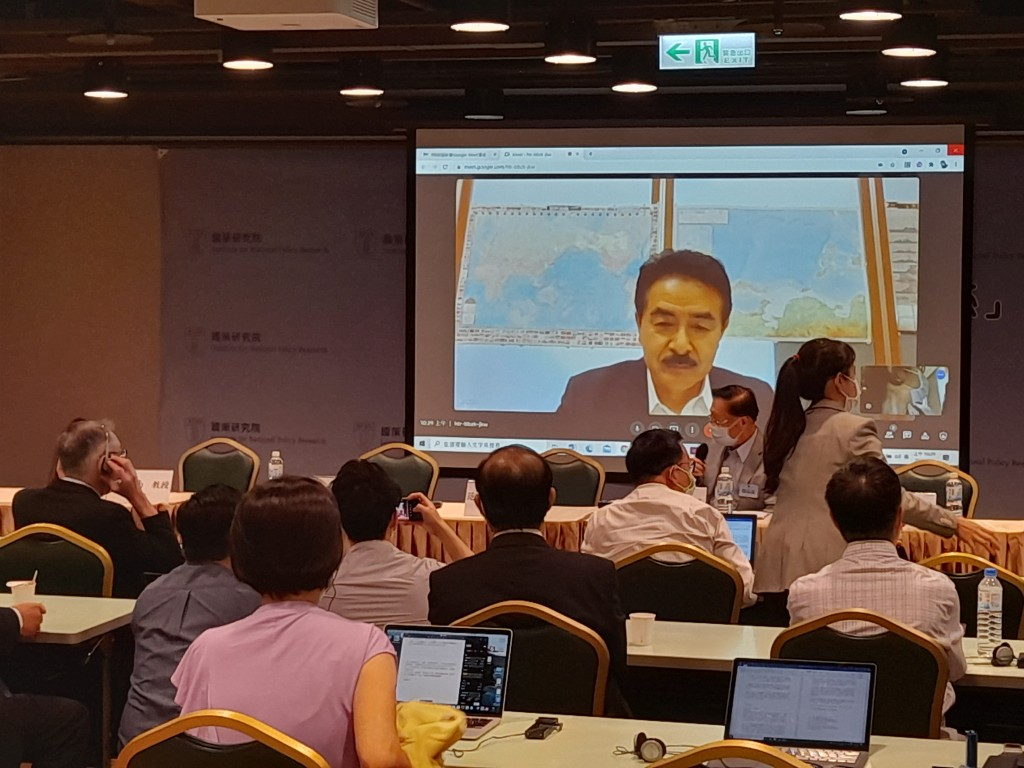 Satoin front of map showingfirst island chain fromperspective of China before making statement. (Taiwan News, Liam Gibson photo)
