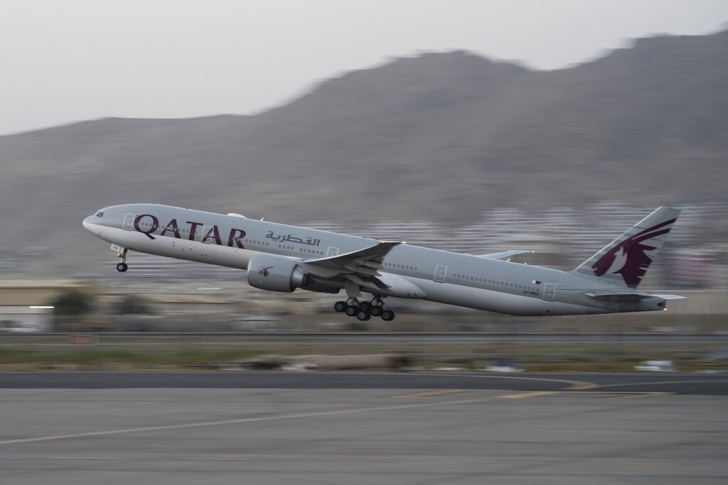 A Qatar Airways aircraft takes off with foreigners from the airport in Kabul, Afghanistan, Thursday, Sept. 9, 2021.