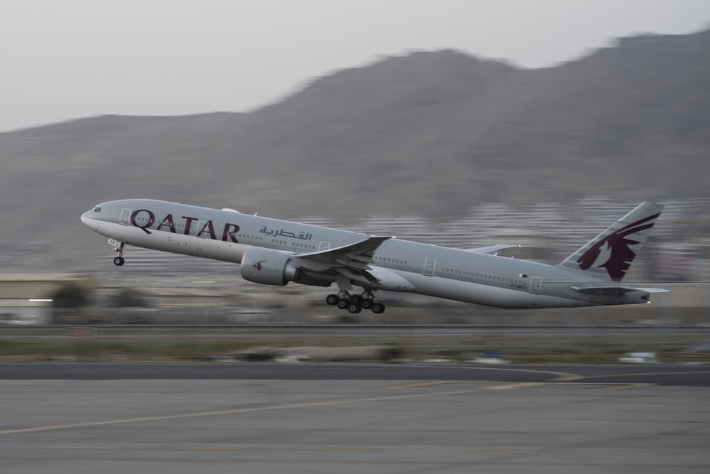 In this Sept. 9, 2021, photo, a Qatar Airways aircraft takes off with foreigners from the airport in Kabul, Afghanistan. U.S. veterans, lawmakers and ...