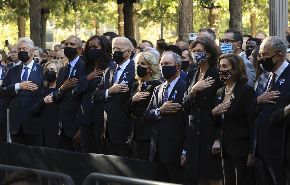 From left, former President Bill Clinton, former First Lady Hillary Clinton, former President Barack Obama, Michelle Obama, President Joe Biden, first...
